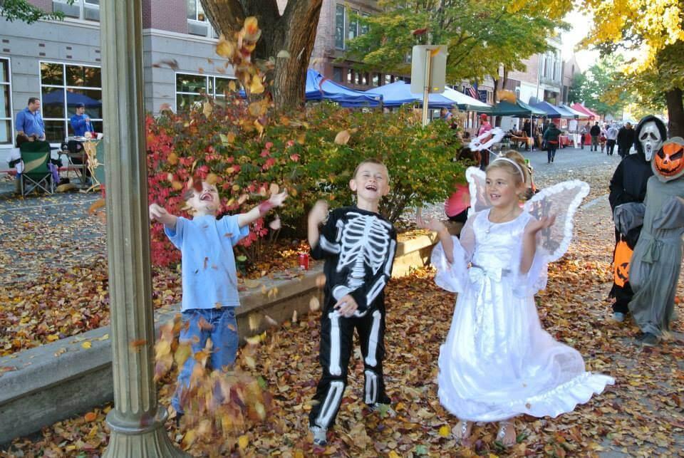 Pumpkin Palooza kids in leaves